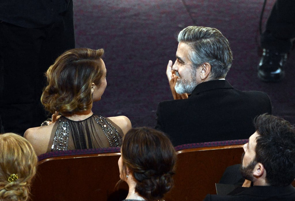 George Clooney and Stacy Keibler had a sweet moment in the audience at the Oscars.