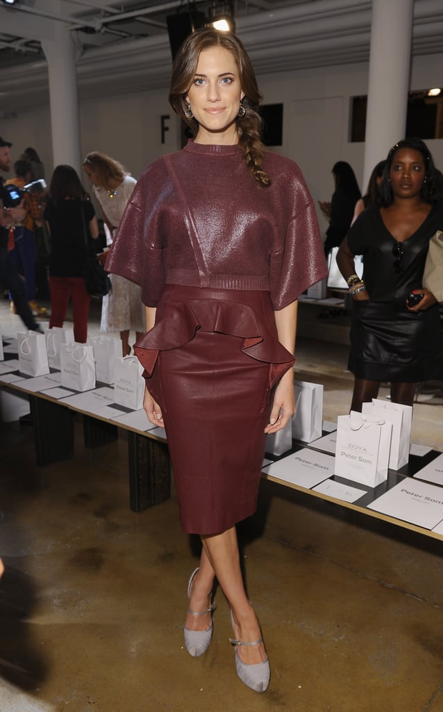 Allison Williams showed off Fall's hottest hue — on a peplum-trimmed leather skirt, no less — front row at Peter Som.