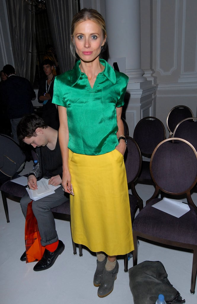 Laura Bailey plays up cool contrasts with a deep green top and a citrus-hued skirt.