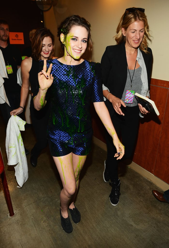 Kristen Stewart looked stunning in slime after winning the favourite actress award at the Kids' Choice Awards in LA in March 2013.