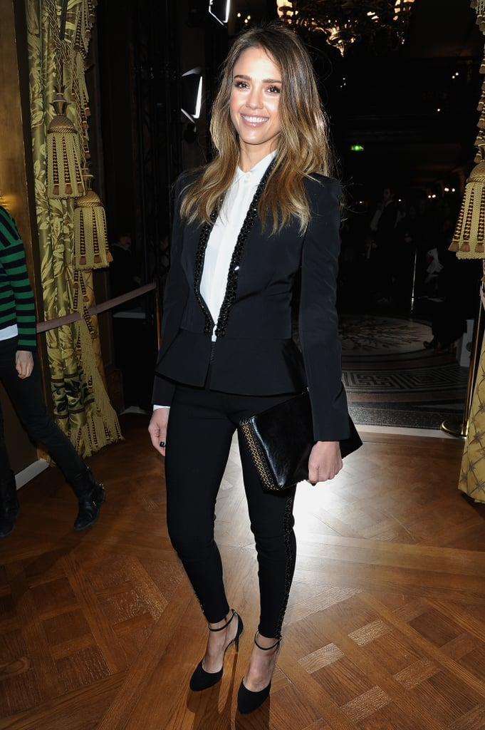At Stella McCartney's show, Jessica Alba suited up in an embellished blazer, cropped pants, a white button-down, and a chain clutch, all by Stella McCartney.