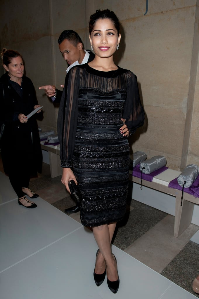 Freida Pinto looked stunning in a sheer black dress at the Salvatore Ferragamo Resort collection show in Paris.