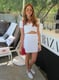 This Coachella party attendee punctuated her cutout white dress with chic shades and a red Céline bag. Source: Chi Diem Chau