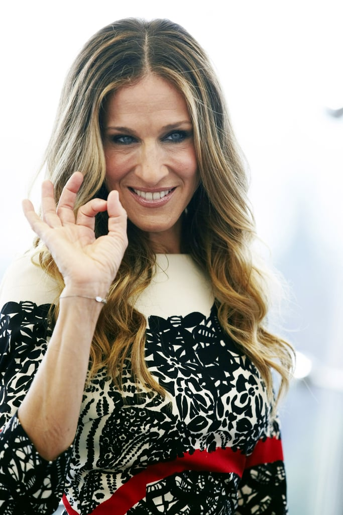 Sarah Jessica Parker smiles while wearing Prabal Gurung in Russia.