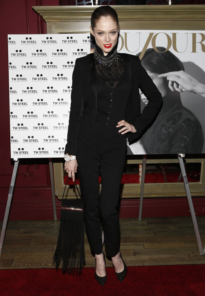 Coco Rocha mixed textures of her sheer Victorian blouse, velvet blazer, and suede pointed pumps combined to create a sophisticated look. She then upped the glam factor with a dazzling diamond choker and black fringe bag.