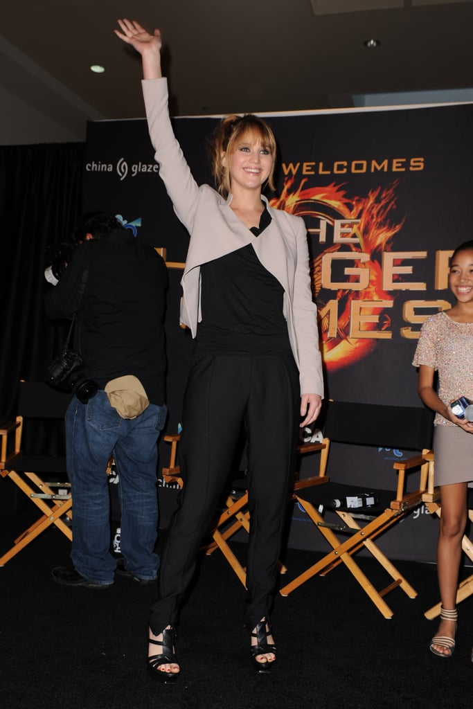 Jennifer Lawrence waved to fans after wrapping up a press day in Florida.