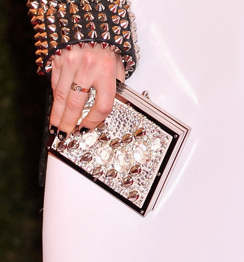 Sienna Miller carried a jeweled Burberry clutch.
