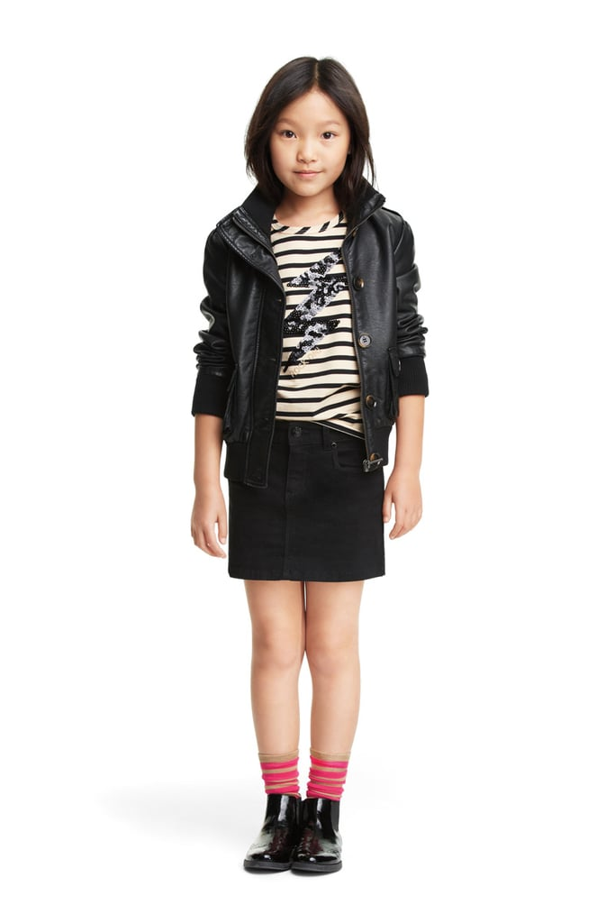 """Downtown chic, scaled down to size — the Wheelie Moto jacket ($39), striped """"blingy"""" top ($14), and a coated mini skirt ($16)."""