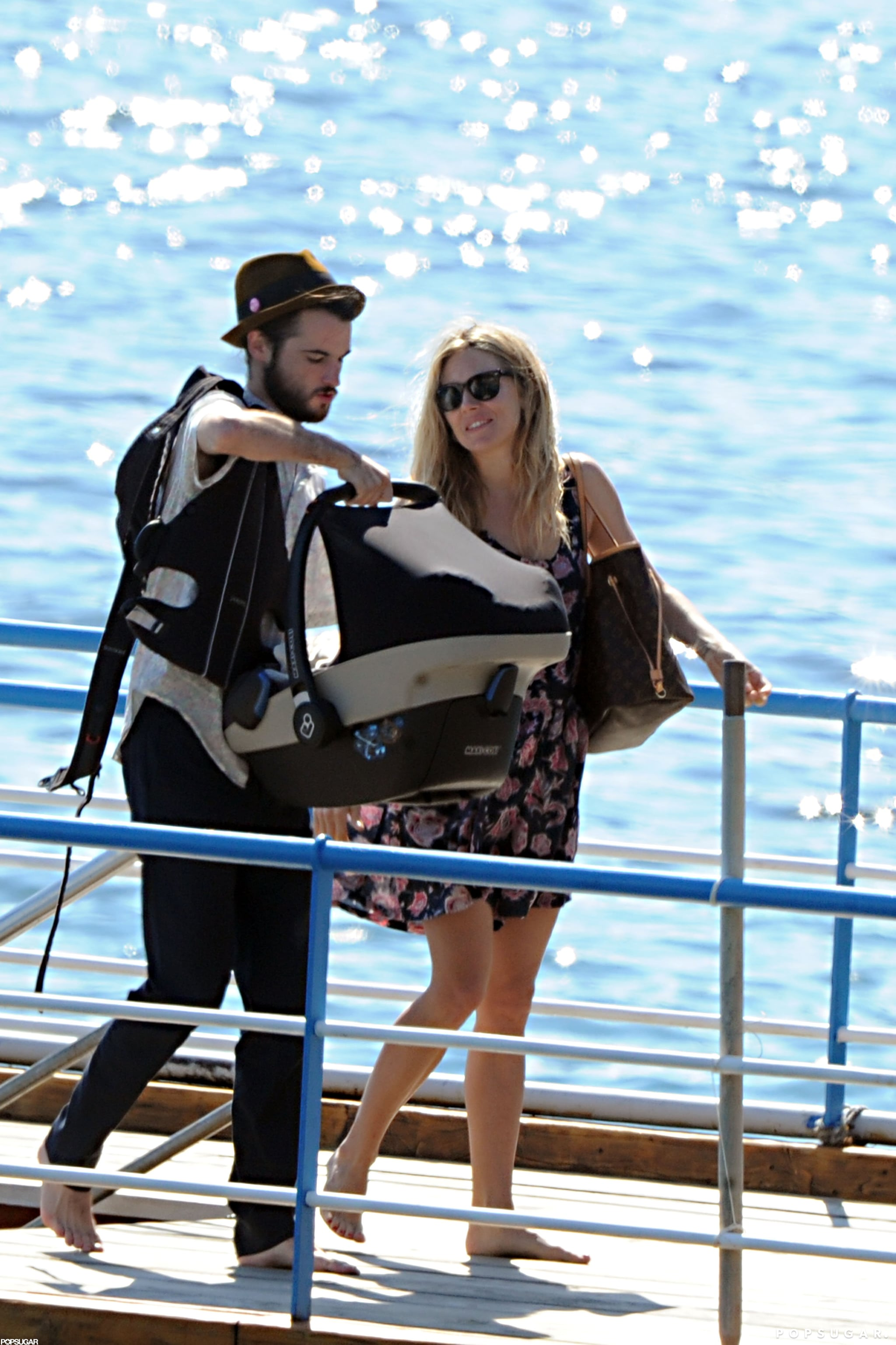 Tom Sturridge carried Marlowe in a carrier off of a boat in Positano with Sienna Miller.