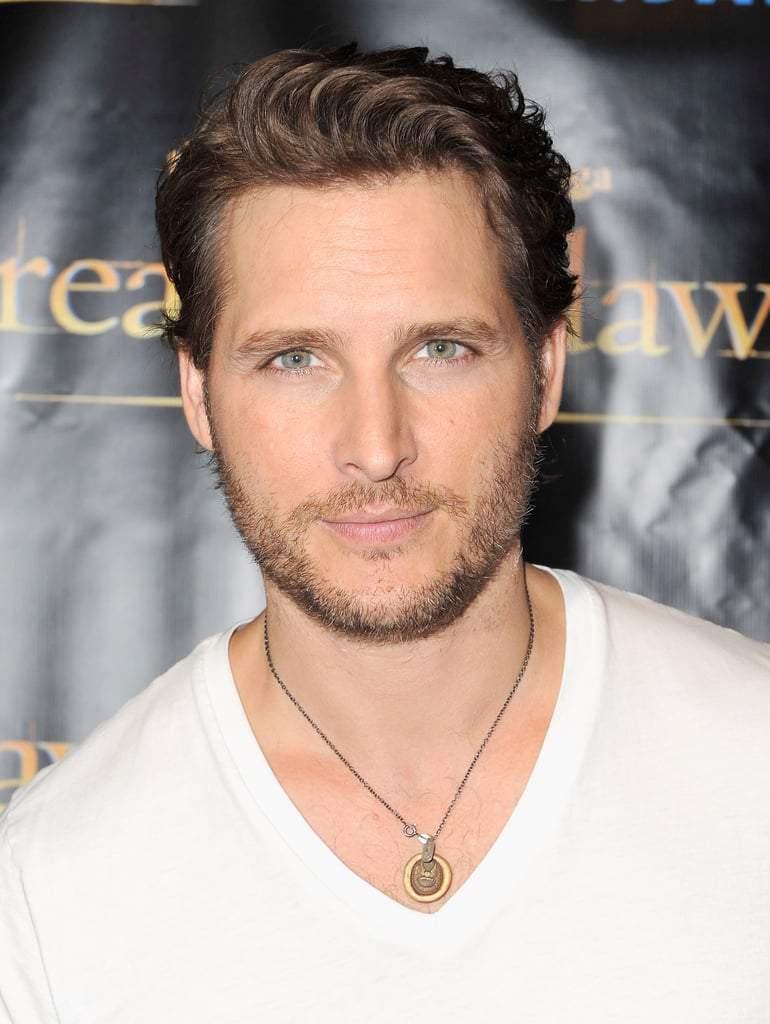 Peter Facinelli wore a white v-neck shirt to the Breaking Dawn Part 2 party at Comic-Con.