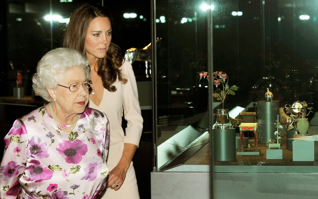 Kate Middleton and Queen Elizabeth look at the Buckingham Palace Summer exhibit.