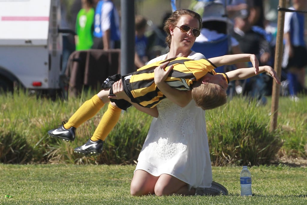Britney Spears helped her son Jayden practice his cartwheels on the sidelines at his soccer game on Sunday in LA.