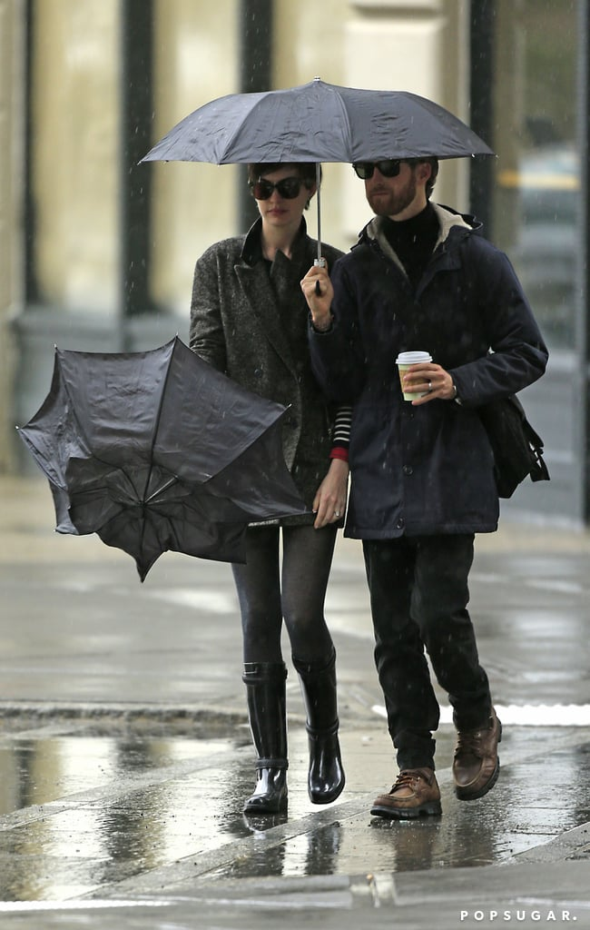 Anne Hathaway and Adam Shulman brought their umbrellas for a coffee date in NYC.