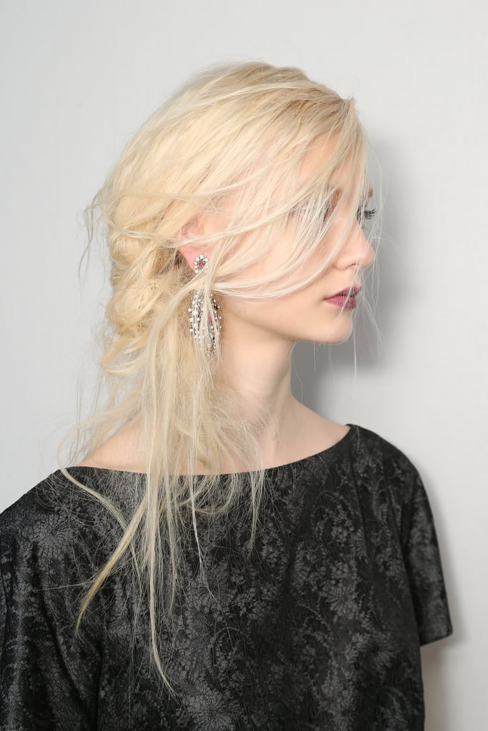 """Rodney Cutler for the Salon at Ulta Beauty created the windblown hairstyle. """"It's slightly romantic with a bit of gothic texture,"""" he explained. Tadashi Shoji wanted the hair low on the neck, so Cutler created a """"knot"""" of """"intertwining hair"""" that was swept over one shoulder."""