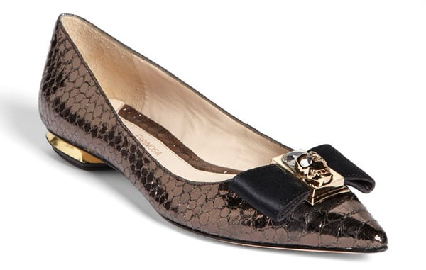 Don't let these copper snakeskin Carolinna Espinosa flats ($295) fool you — they're not all sweet. Atop that bow sits a fierce skull detail.