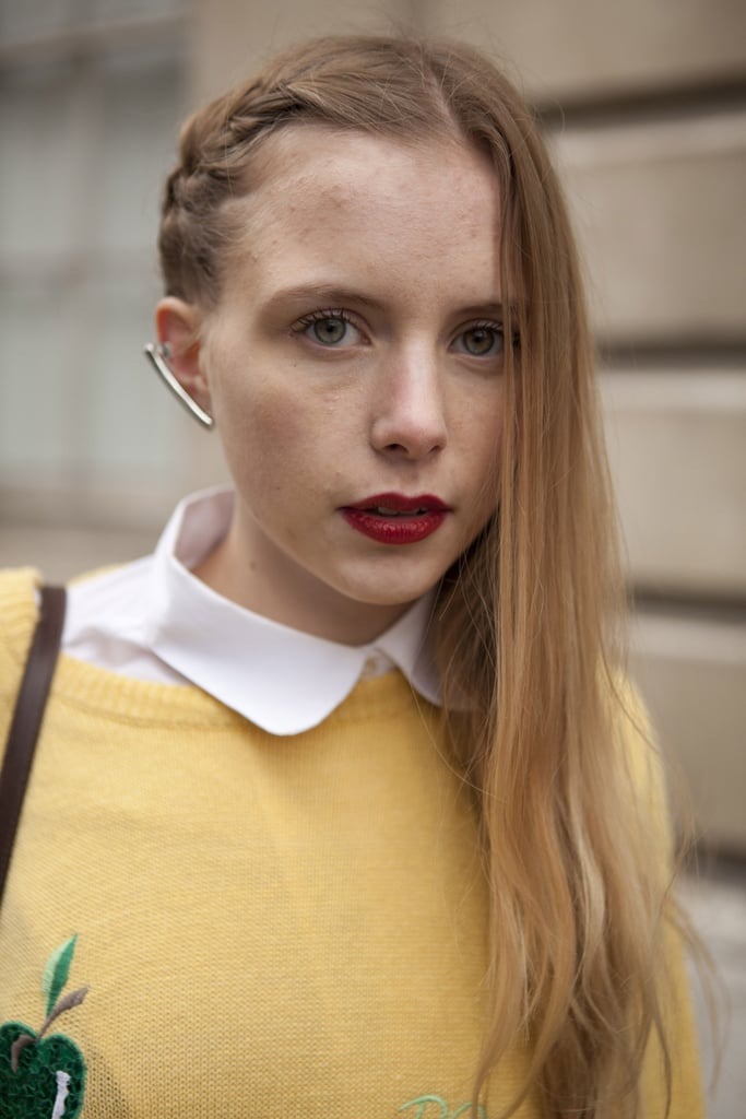 A braid/blow-dry hybrid style stayed grounded with a swipe of red lipstick.
