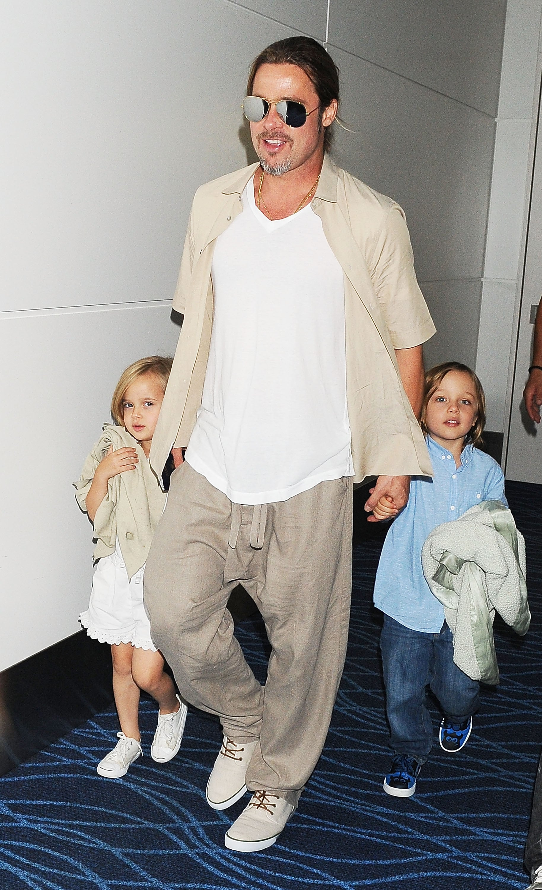 Brad Pitt walked with Vivenne and Knox in Tokyo on Tuesday.