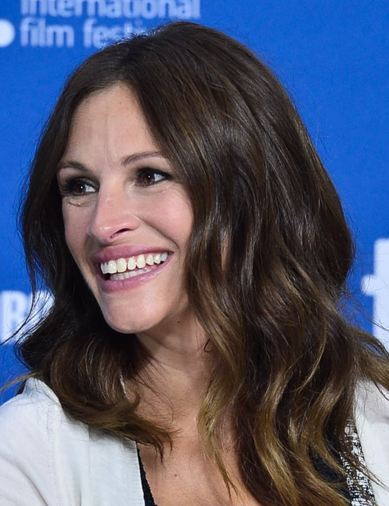 At the August: Osage County press conference, Julia Roberts flashed her famous smile and a pale pink lip.
