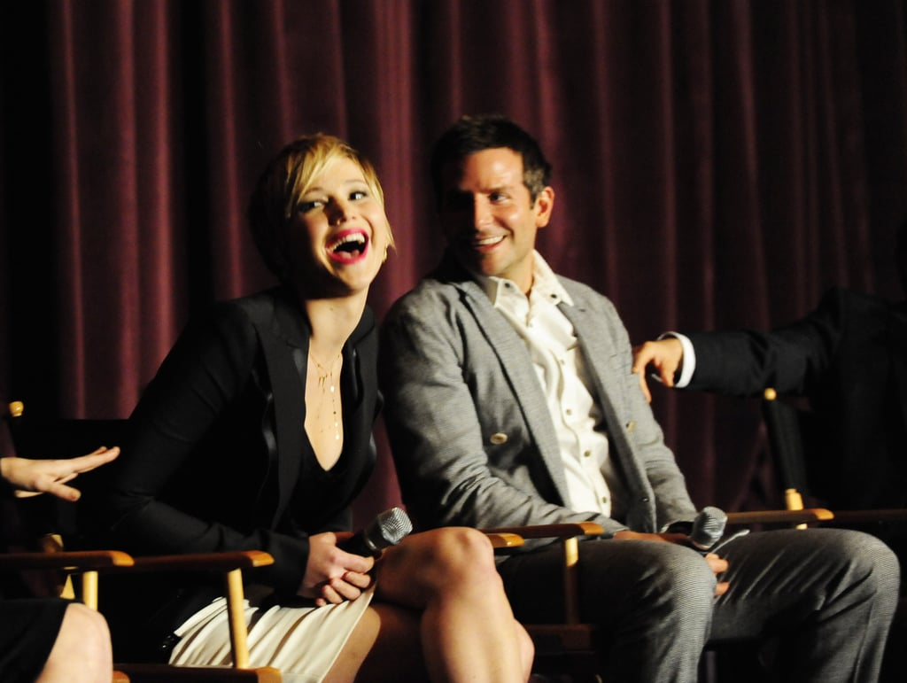 Jennifer Lawrence and Bradley Cooper shared a laugh on Saturday during a Q&A for American Hustle.