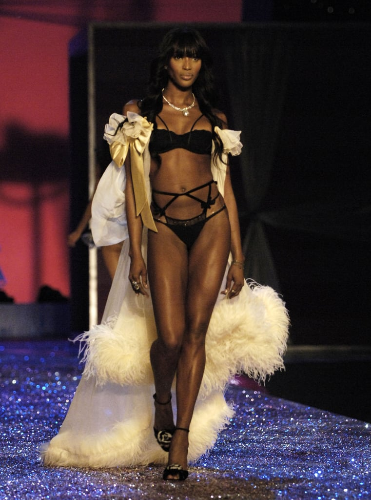 Naomi donned a chic black and white ensemble on the runway in 2005.