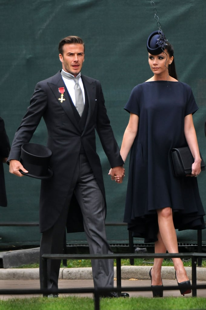 Victoria Beckham made an entrance in a high-low dress and matching navy fascinator at the April 2011 royal nuptials of Prince William and Kate Middleton in London. David was dapper too! Mimic Victoria's regal style by matching a loose-fitting dress with an over-the-top hat.