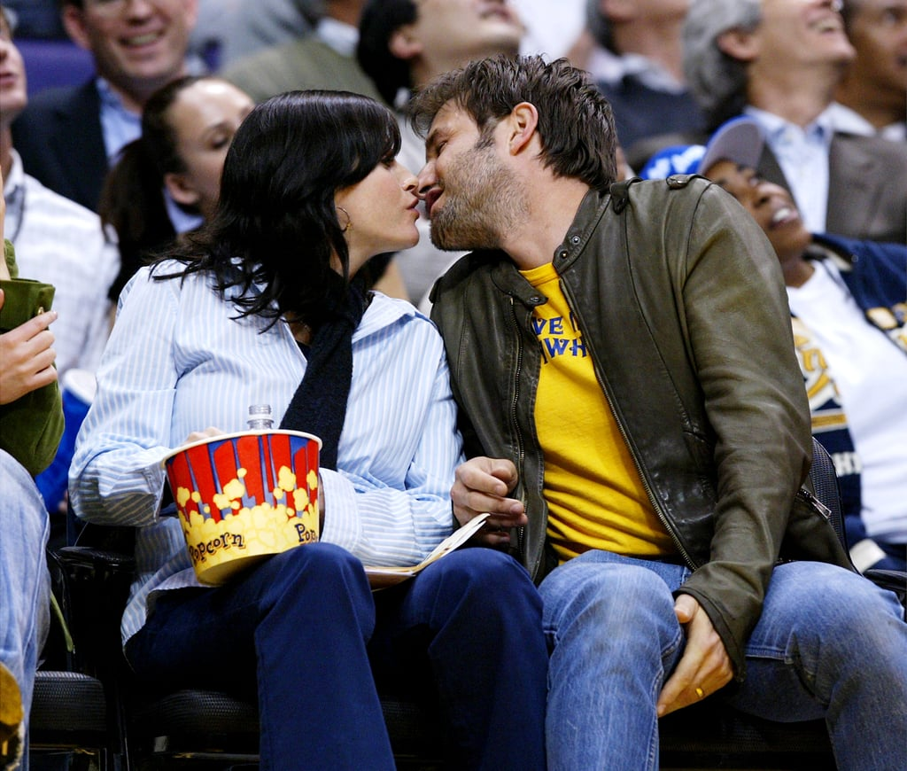Courteney Cox and David Arquette were caught kissing while eating popcorn at a Lakers game.