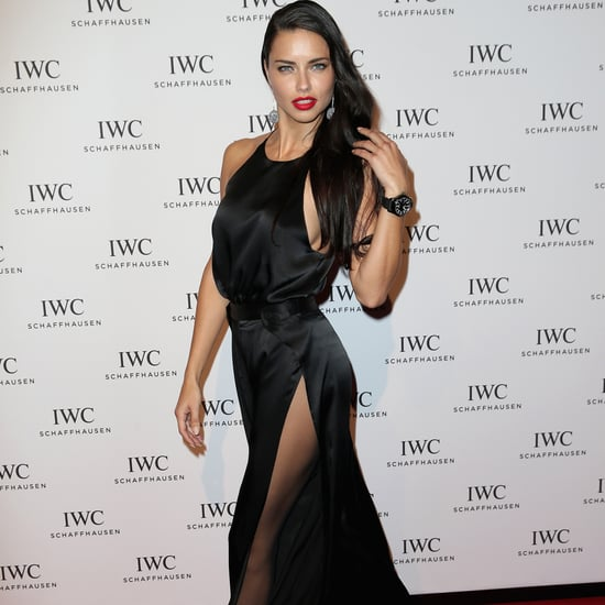 Adriana Lima Wears a Sexy Black Dress and Red Lipstick