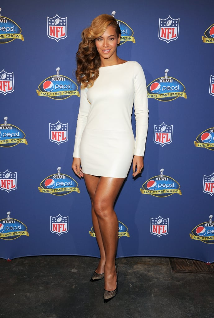Beyoncé wowed at the Super Bowl halftime press conference — and not just because of her impromptu performance — with a jaw-dropping little white dress by Olcay Gulsen.