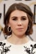 Zosia Mamet's coal-rimmed eyes popped against her floral dress.