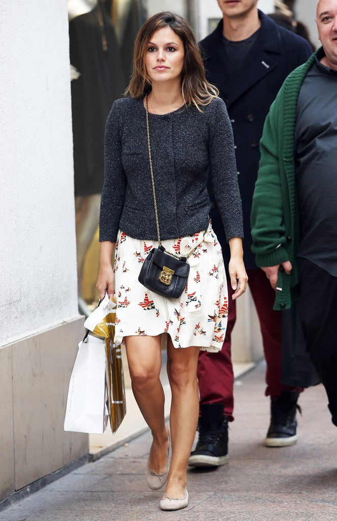 Rachel Bilson took a daytime stroll, Cannes-style, looking comfortable and cute in a printed skirt, a collarless jacket, a mini crossbody bag, and ballet flats.
