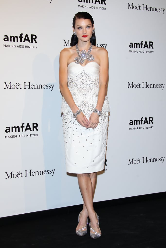 Jessica Stam opted for an ultra-glam confection and a red lip for a night out at amfAR.