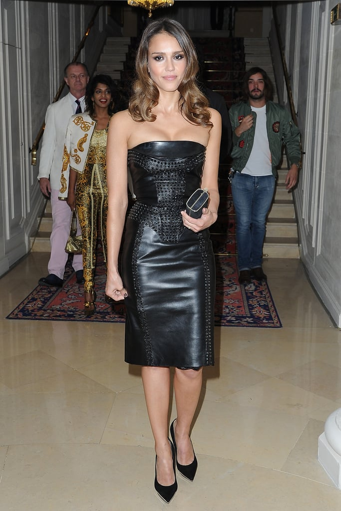 Jessica Alba suited up in a curve-conscious Versace leather strapless.