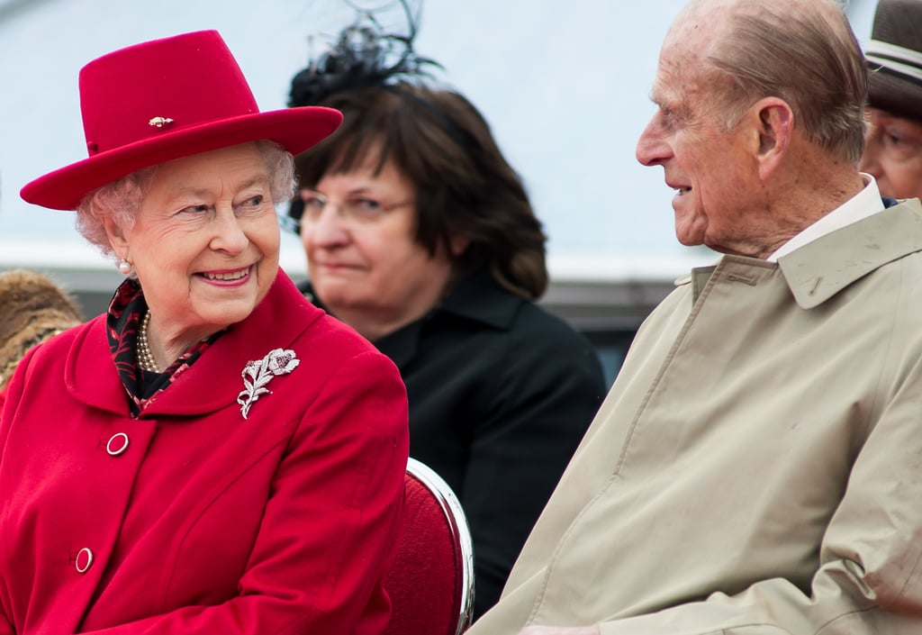 The Queen flashed a smile at her husband.