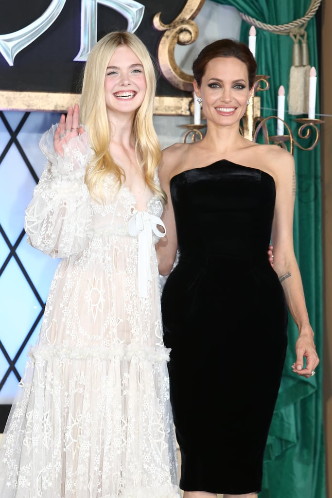 Elle Fanning and Angelina Jolie were all smiles on the red carpet at the Tokyo premiere of Maleficent on Monday.
