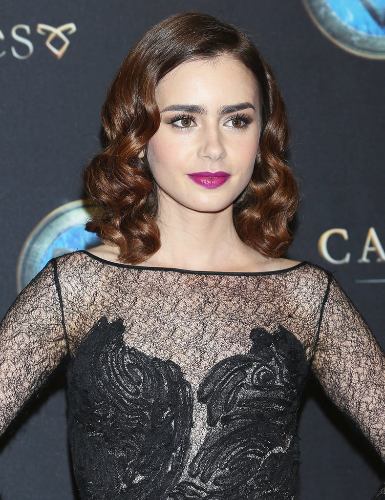 At the Mexico City premiere of The Mortal Instruments: City of Bones, Lily Collins tried out a glamorous look complete with glossy waves and a purple lip.