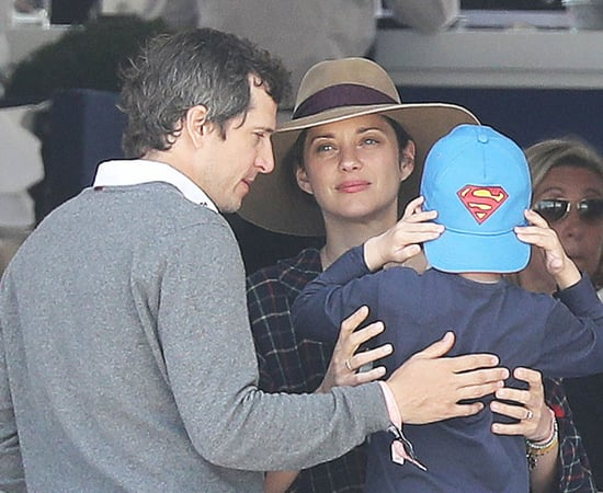Marion Cotillard and Guillaume Canet at the Longines Athina Onassis Horse Show in St Tropez with their son
