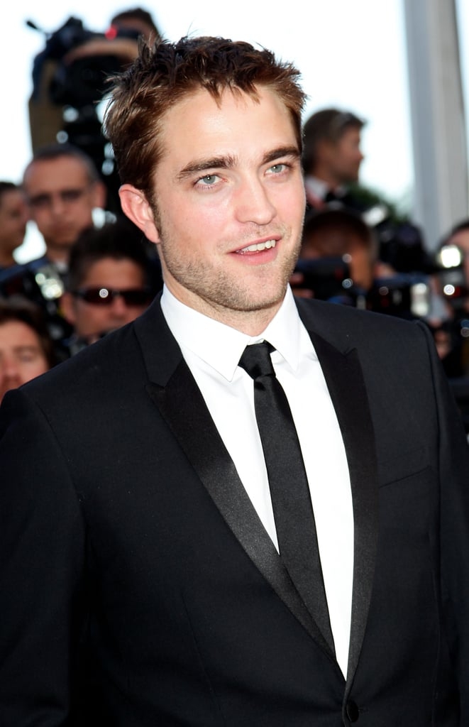 Robert Pattinson smiled on the red carpet for girlfriend Kristen Stewart's On the Road premiere at the Cannes Film Festival.