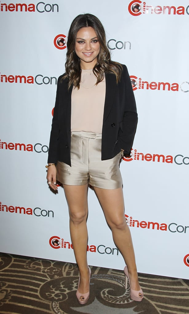 Mila Kunis paired gold shorts with a blazer for the CinemaCon event in Las Vegas.