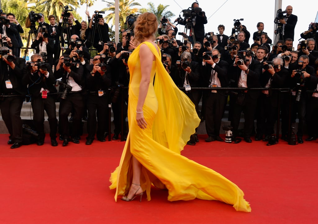 Uma Thurman stunned in a yellow dress at the Clouds of Sils Maria premiere.