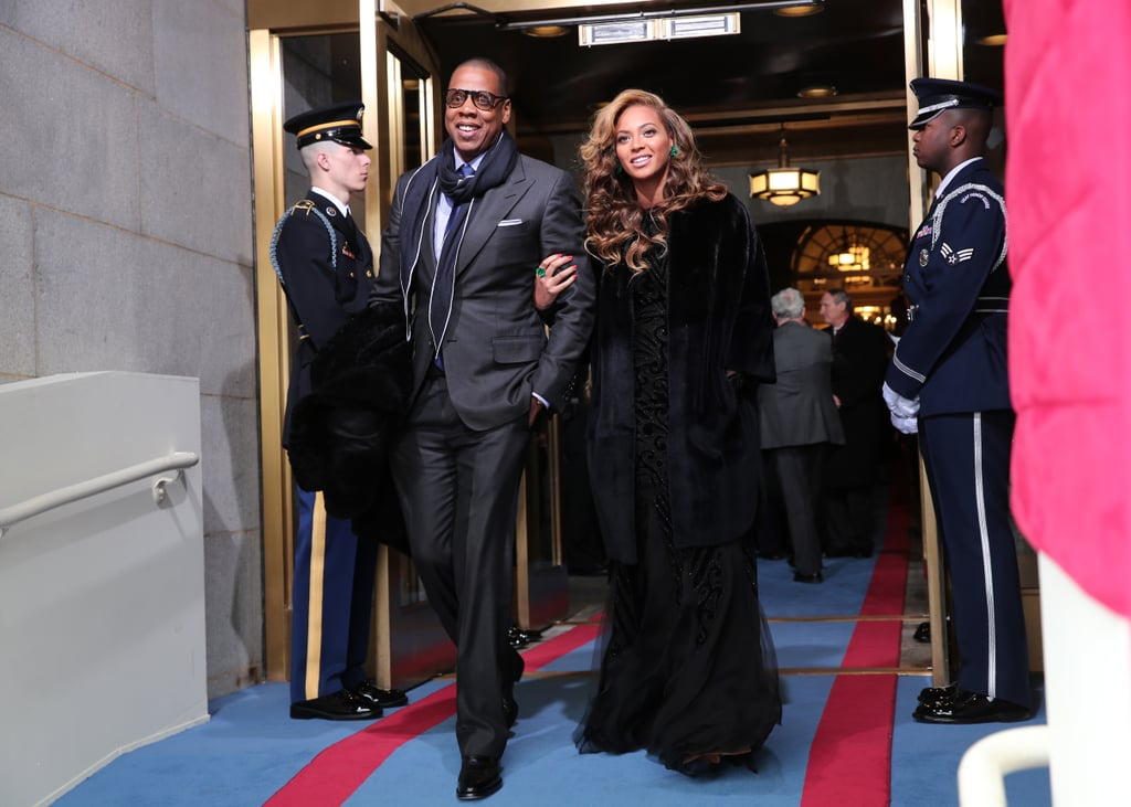 Jay-Z and Beyoncé arrived at the 2013 Inauguration Day together — Beyoncé wore a black embellished Emilio Pucci gown layered with a knee-length Christion Dior coat.