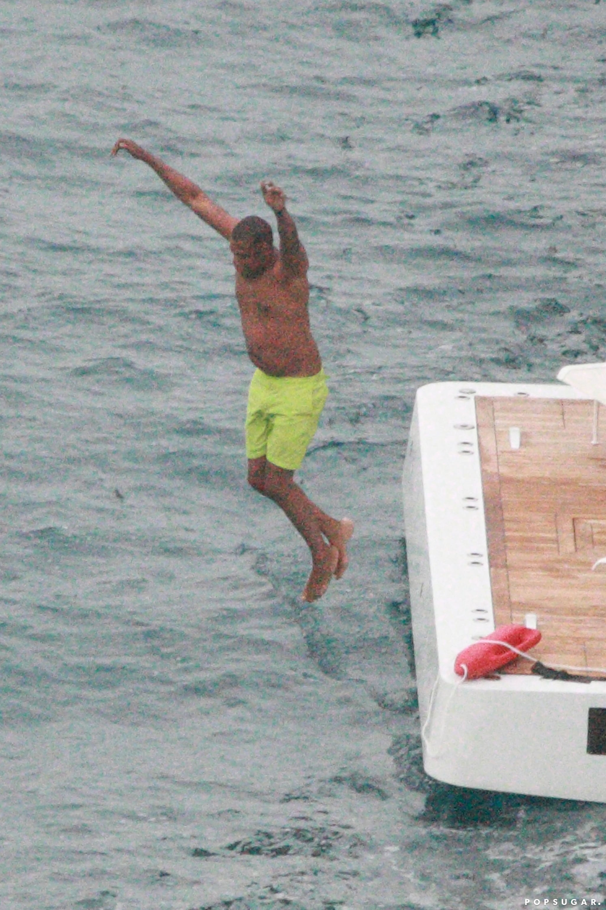 Jay Z jumped into the water.