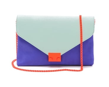 Loeffler Randall's colorblocked clutch ($295) would shine in the night. The colors are great together, and the orange chain strap is too cool for words.