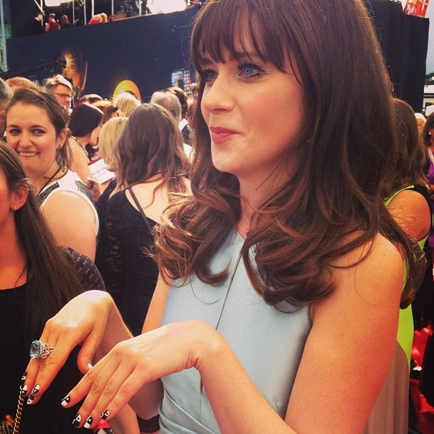 Zooey Deschanel showed off her adorable manicure and giant Chanel ring on the red carpet. Source: Instagram user instylemagazine