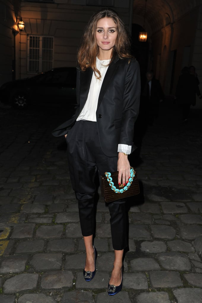 Olivia Palermo attended the Hogan presentation in a cropped black suit paired with blue Manolo Blahnik heels and a statement clutch.