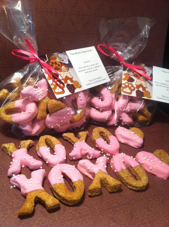 """Let's be honest: you can dress your pup in all the Valentine's Day gear you want, but he only has one thing on his mind. Food. Satisfy his inner desires with these XOXO cookies in peanut butter and """"pooch munchie"""" flavors."""