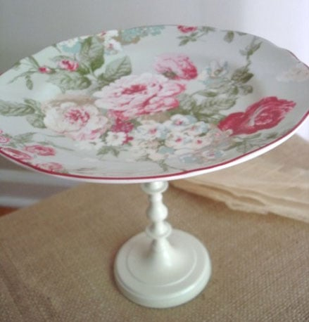 I've seen some really pretty cake stands like this Shabby Rose Vintage-Inspired Dessert Pedestal ($22) that are made from antique plates. A mismatched grouping would be darling.