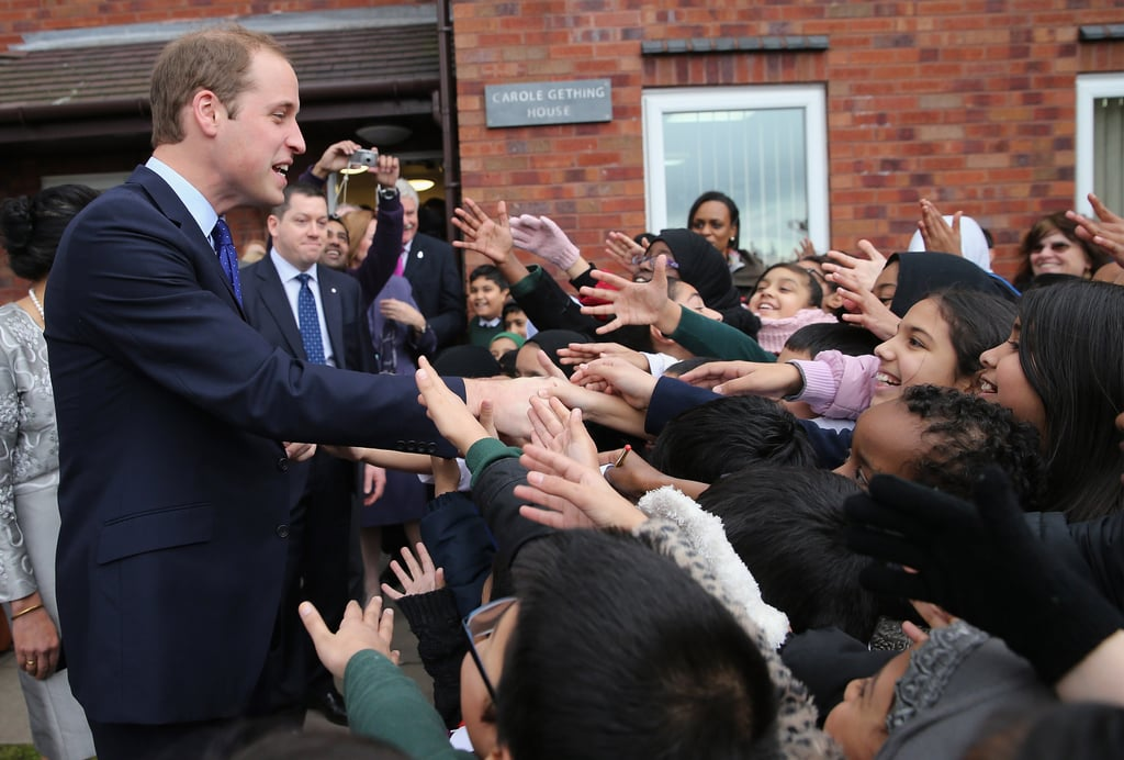 Prince William shook hands with kids while visiting the library in Birmingham.