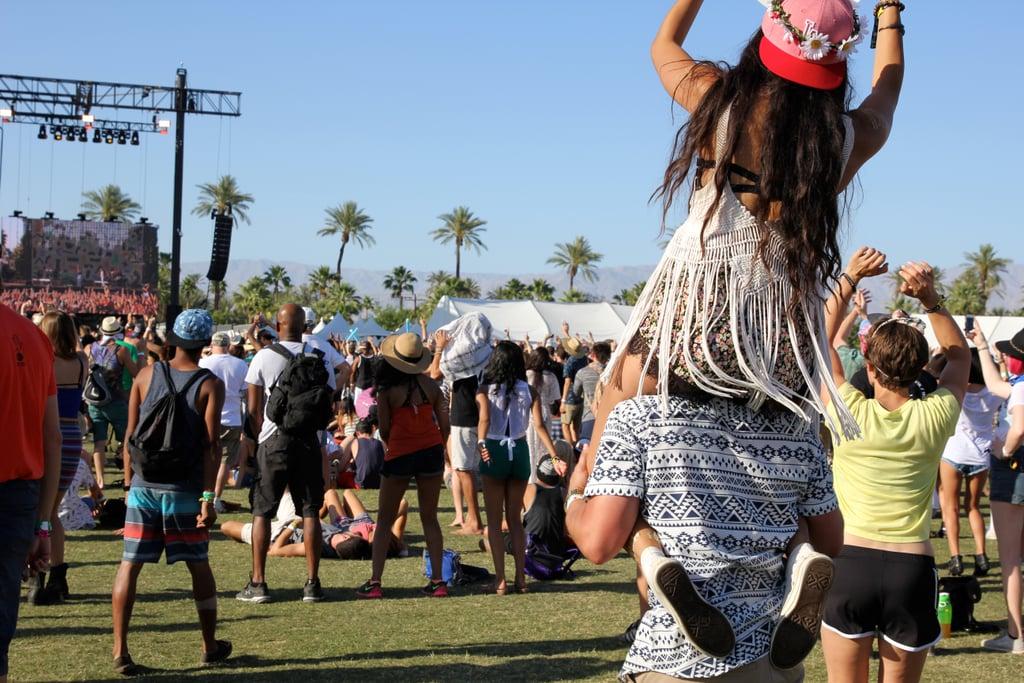A girl got a piggy-back ride at Coachella in 2015.