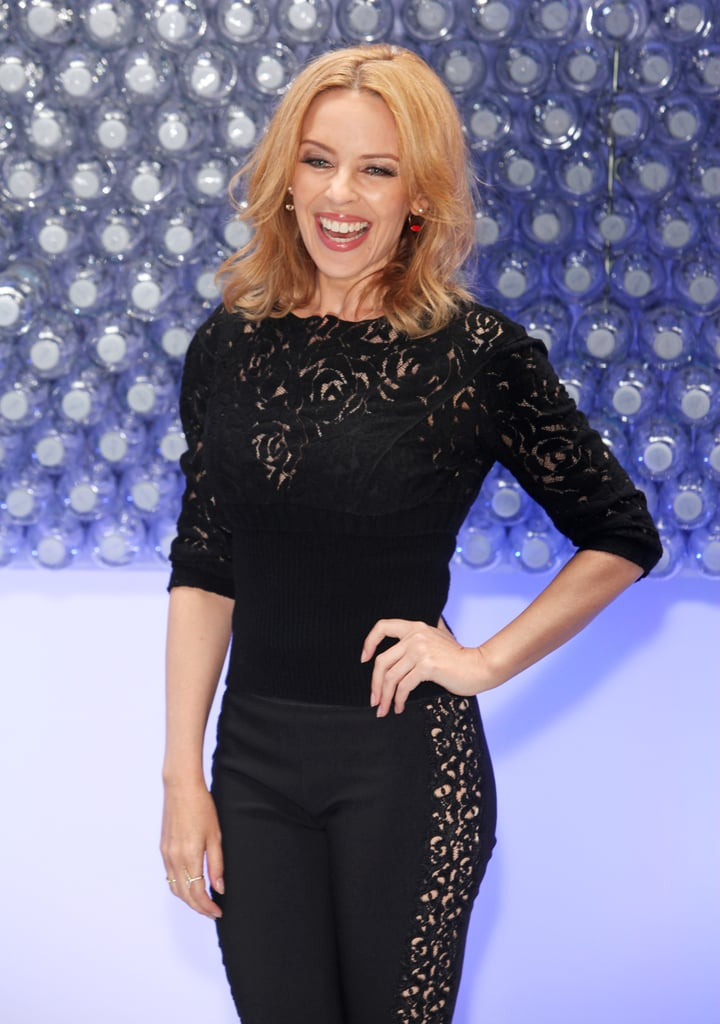 Kylie Minogue posed with a smile in London on Thursday.