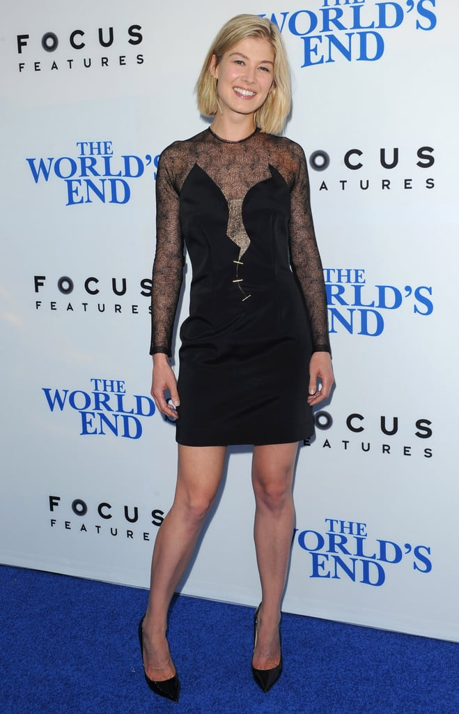 What would be a prim and proper black dress gets sexy on Rosamund Pike thanks to sheer sleeves and a low-dipping neckline. The actress finished things off with Jennifer Meyer jewelry.